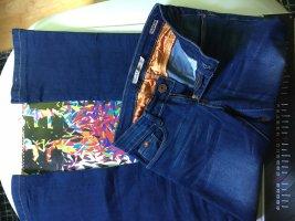 Toxik3 Jeansowe spodnie dzwony niebieski