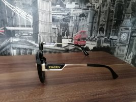 Versace Ovale zonnebril zwart-goud