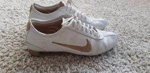 weiß goldene Nike Shox