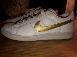 Weiße Nike sneaker mit goldenem Logo Gr.37,5