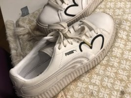 Weiße Puma sneaker