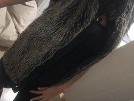 Chaleco de piel negro-color bronce
