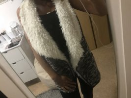 Chaleco de piel blanco-negro