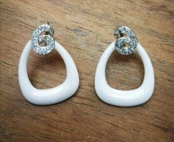 Juwelier Boucle d'oreille incrustée de pierres blanc