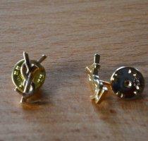 Yves Saint Laurent Broche color oro metal