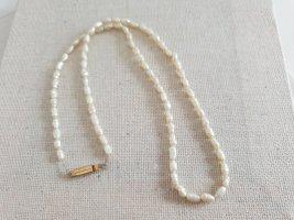 Collana di perle beige chiaro