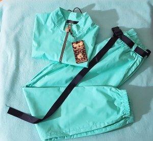 Traje de pantalón turquesa
