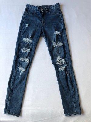 5 Pocket high waste skinny Jeans mit modernen destroyed Details
