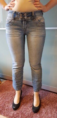 7 /8 Stretch-Jeans mit ausgestelltem Bein im Used-Look