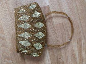 Bolso tipo pochette color oro