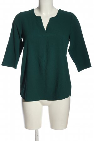 About You Blusa caída verde look casual