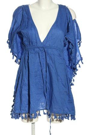 Accessorize Blusa larga azul look casual