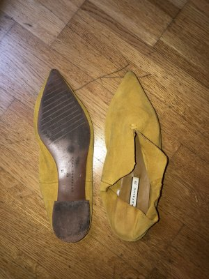 Acne ähnliche Slipper in gelb
