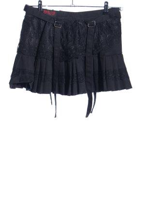 ADERLASS Falda de patinador negro estampado floral elegante
