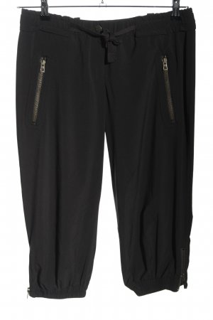 Adidas by Stella McCartney Pantalón pirata negro look casual