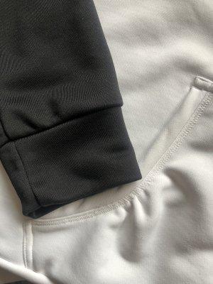 Adidas Jack met capuchon zwart-wit