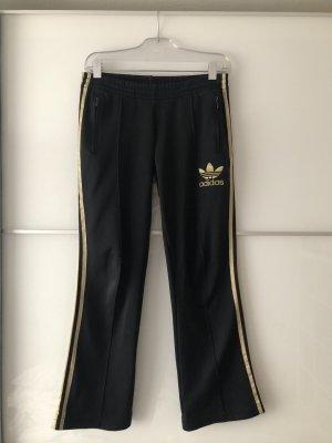 Adidas Jogginghose schwarz/gold