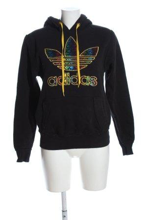 Adidas Sweatshirt met capuchon zwart-sleutelbloem prints met een thema