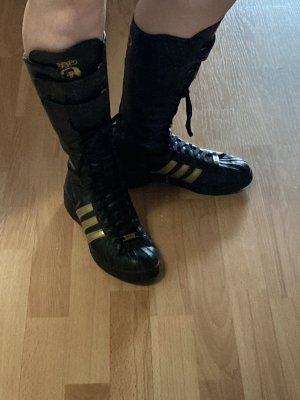 Adidas Stivale stringato nero-oro