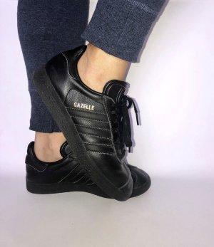Adidas Originals Basket à lacet noir-doré cuir
