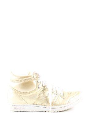Adidas Schnürsneaker goldfarben extravaganter Stil