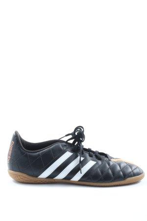 Adidas Schnürsneaker schwarz-hellorange Steppmuster sportlicher Stil