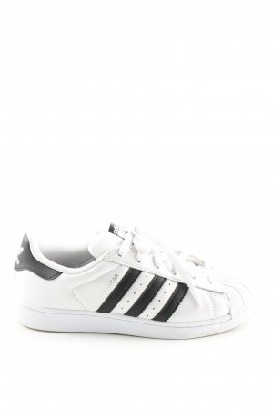 Adidas Schnürsneaker weiß-schwarz Streifenmuster Casual-Look