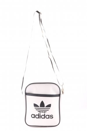 Adidas Bolsa de hombro blanco-negro look casual