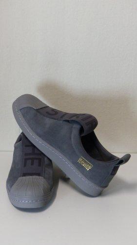 Adidas Originals Zapatillas deslizantes gris oscuro-gris Cuero