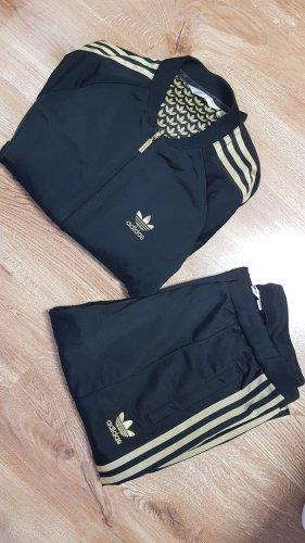 Adidas Twin set in jersey nero-oro Tessuto misto