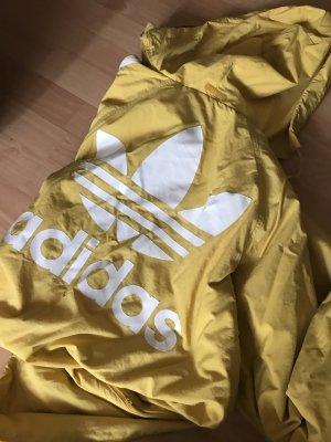 Adidas Zware regenjas geel-wit