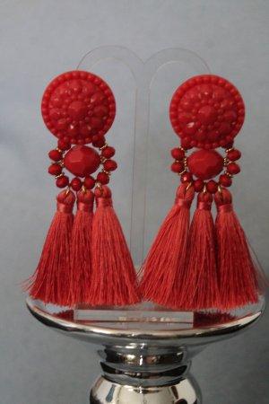 Boucle d'oreille incrustée de pierres saumon-rouge clair
