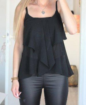 • Ärmellose Bluse
