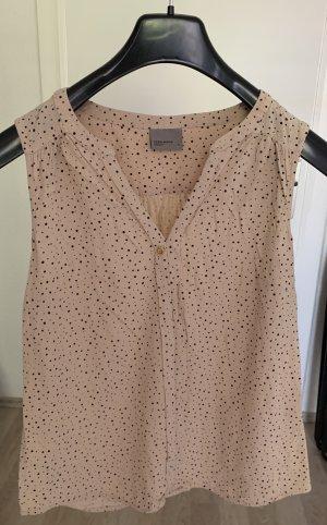 ärmellose Bluse in beige mit schwarzen Punkten
