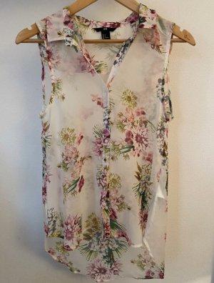 Ärmellose Bluse mit Blütenprint.