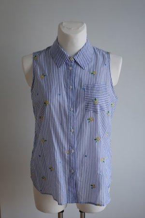 Ärmellose Bluse mit Stickereien