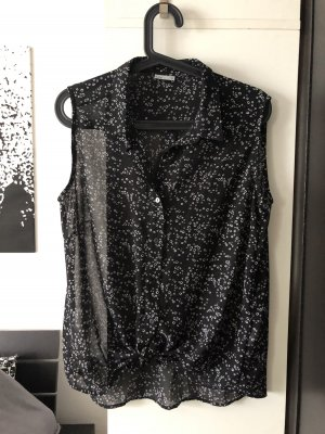 Ärmellose Bluse schwarz weiß