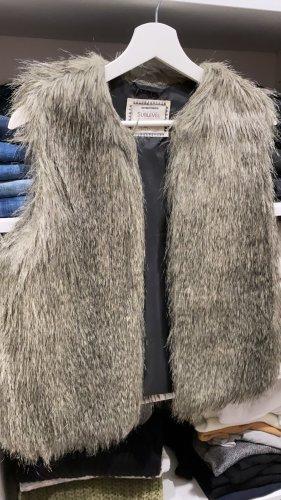 Chaleco de piel marrón claro-gris