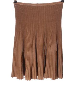 Alaïa Falda plisada marrón look casual