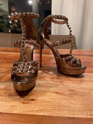 Alaïa Sandalias de tacón de tiras color bronce