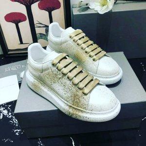 Alexander McQueen High top sneaker wit-goud