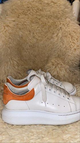 Alexander McQueen High top sneaker donker oranje-wit Leer