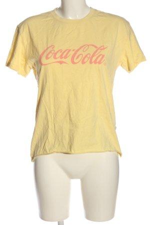 America Today Camiseta amarillo pálido-rosa letras impresas look casual