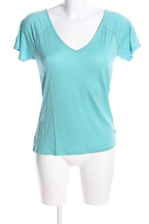 America Today Camisa con cuello V turquesa look casual
