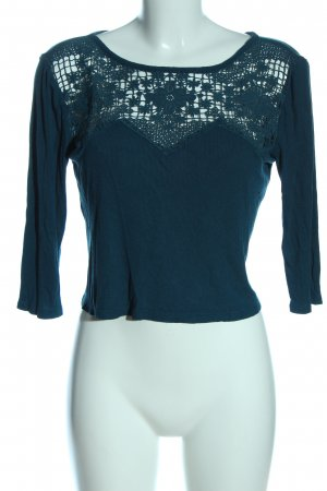 American Eagle Outfitters Blusa caída turquesa look casual