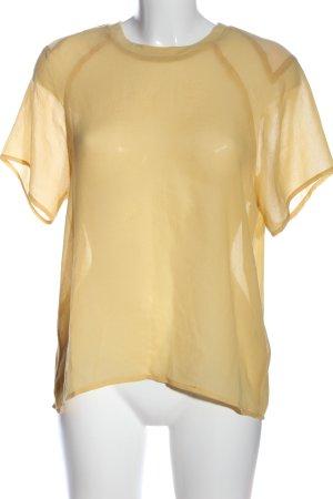 American Vintage Blusa transparente amarillo pálido look casual