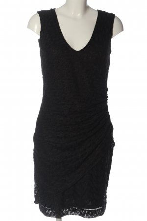 Ana Alcazar Vestido a media pierna negro estampado floral elegante