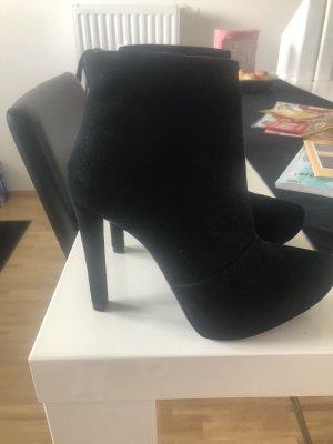 Zara Patucos con plataforma negro