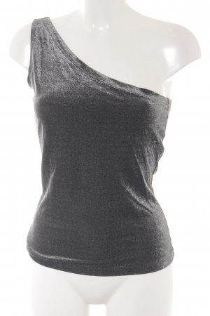 Anna von Griesheim Top de un solo hombro color plata moteado look casual