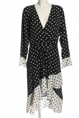annalisa Jurk met lange mouwen zwart-wit gestippeld patroon extravagante stijl